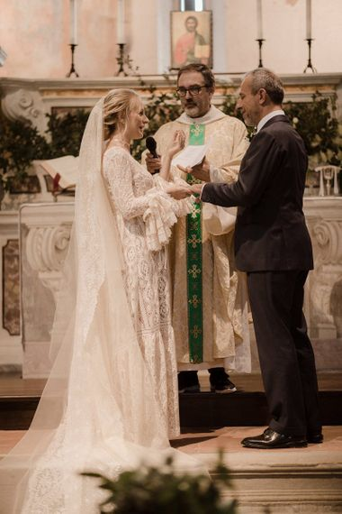 Bride in Bell sleeve wedding dress at ceremony in Italy