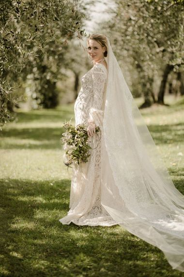 Bell sleeve wedding dress from Daphne Milano