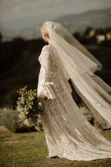 Bell sleeve wedding dress from Daphne Milano with tiered veil