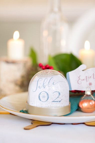 Snow Globe Table Number For Wedding // Gingerbread House For A Festive Christmas Wedding With Red And White Florals Stag Motif Stationery Planned & Styled By La Fete Anneli Marinovich Photography