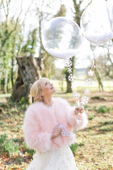Giant Balloon Props For Wedding Photographs // Gingerbread House For A Festive Christmas Wedding With Red And White Florals Stag Motif Stationery Planned & Styled By La Fete Anneli Marinovich Photography