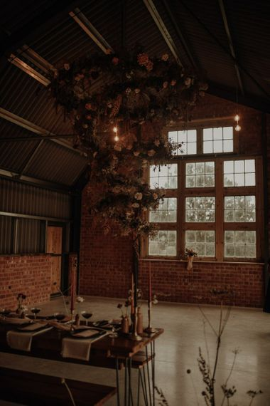 hanging spiral flower installation at the Giraffe Shed