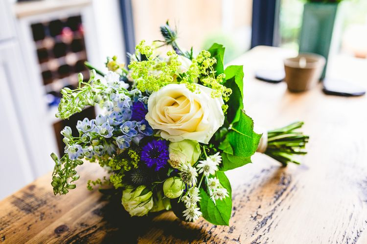 Structured Wedding Bouquet In Blues And Creams // The Old Parish Rooms Rustic Wedding With Giant Banner For Sweetheart Table And Images From Love That Smile Photography Film From White In Motion