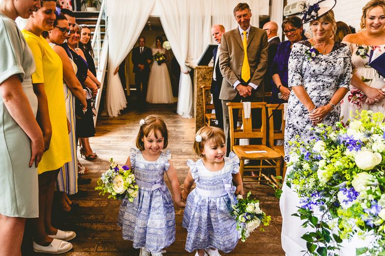 Flower Girls In Blue Dresses // The Old Parish Rooms Rustic Wedding With Giant Banner For Sweetheart Table And Images From Love That Smile Photography Film From White In Motion