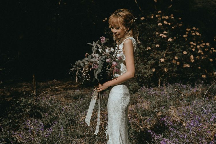 Beautiful Bride in Boho Lace Wedding Dress with Wildflower Bouquet