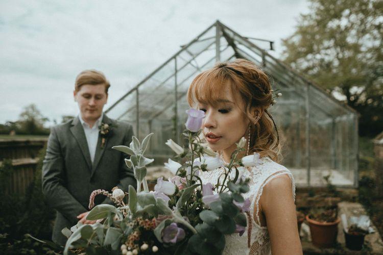 Beautiful Oriental Bride Holding a Wildflower Wedding Bouquet
