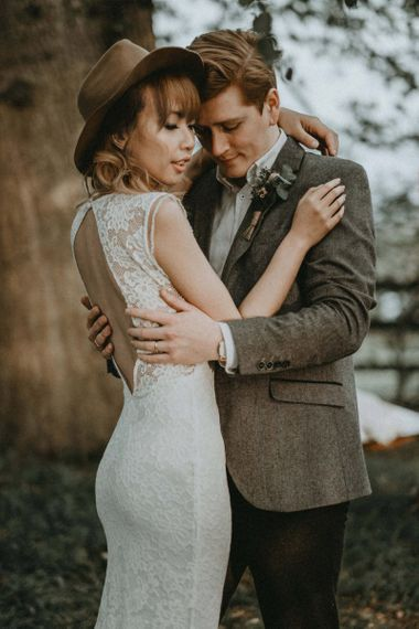 Groom in Wool Blazer and Bride in Lace Backless Wedding Dress and Felt Hat