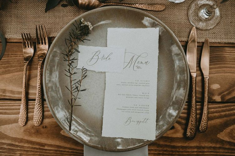 Place Setting with Charger Plate, Gold Flatware and Menu Card