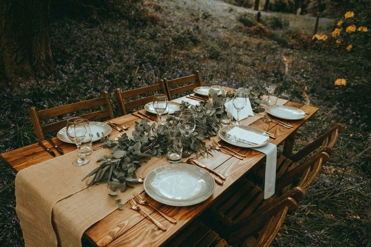Rustic Tablescape with Wooden Tablescape, Burlap Table Runner and Greenery Centrepiece
