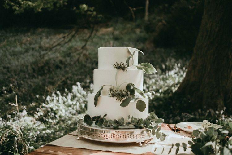 Three Tier White Wedding Cake with Eucalyptus Decor