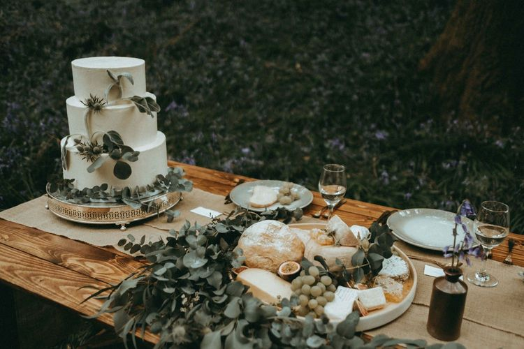 Cheese and Bread Grazing Table and Three Tier White Wedding Cake