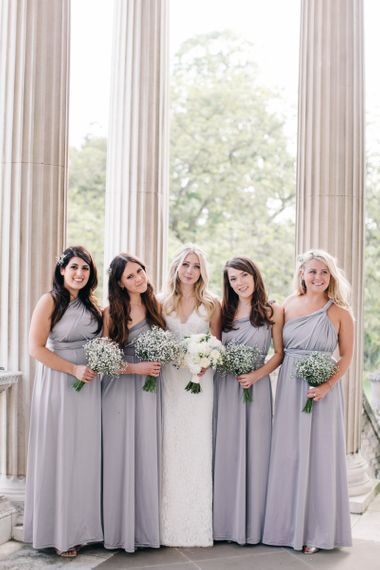 Elegant grey bridesmaid dresses with gypsophila bouquets