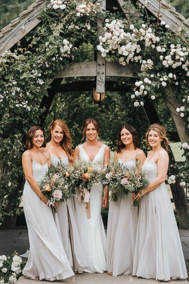Bridal party portrait with bridesmaids in grey dresses
