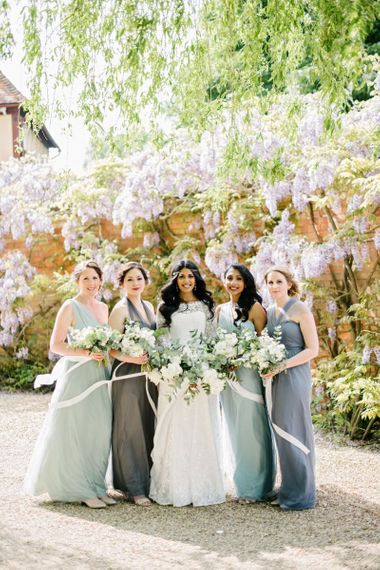 Mis-match bridesmaid dresses in grey and green