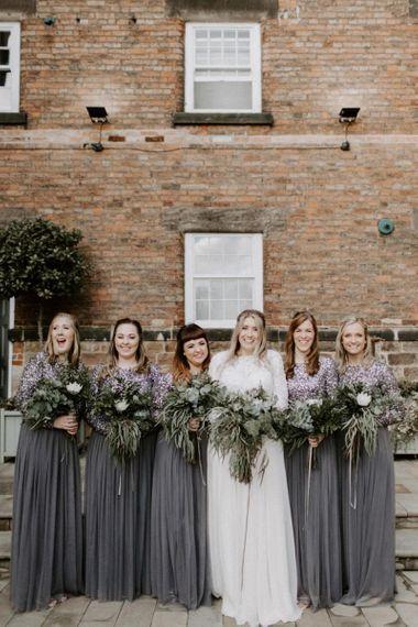 Bridesmaids in charcoal grey sequin dresses