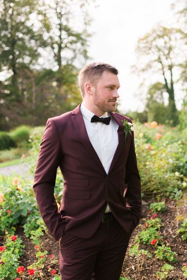 Burgundy Coloured Suit with Black Bow Tie