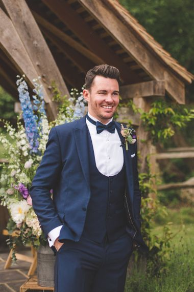 Navy Three-piece Suit with Bow Tie and Horseshoe Waistcoat