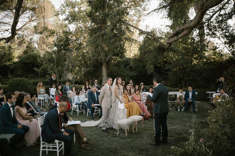 Outdoor Wedding Ceremony   Bride in Strapless Embroidered Wedding Dress by Rara Avis   Groom in Beige Suit with Ochre Tie   Fairytale Tuscan Wedding with Bride in Embroidered Dress   Andrea & Federica Photography