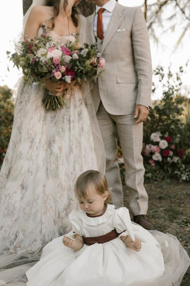 Outdoor Wedding Ceremony   Bride in Strapless Embroidered Wedding Dress by Rara Avis   Groom in Beige Suit with Ochre Tie   Romantic Bridal Bouquet   Flower Girl   Fairytale Tuscan Wedding with Bride in Embroidered Dress   Andrea & Federica Photography