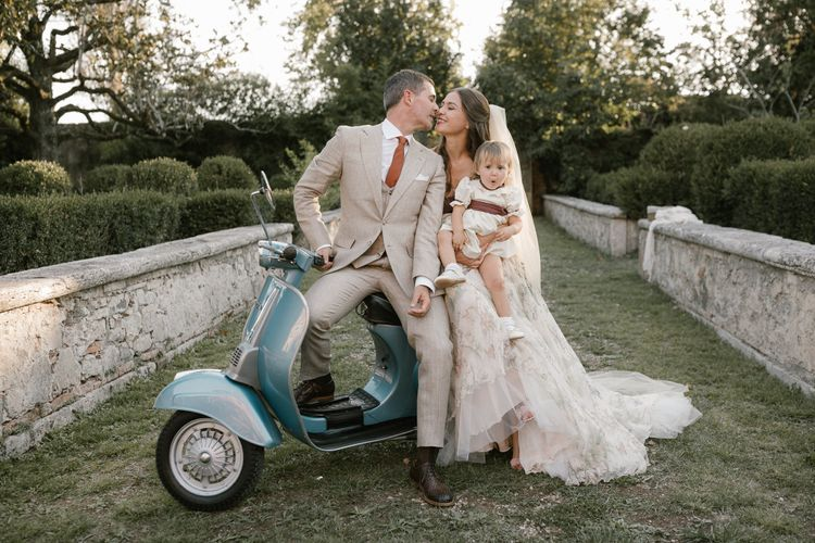 Blue Scooter   Bride in Strapless Embroidered Wedding Dress by Rara Avis   Groom in Beige Suit with Ochre Tie   Flower Girl in White Dress   Fairytale Tuscan Wedding with Bride in Embroidered Dress   Andrea & Federica Photography