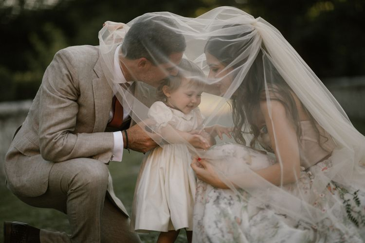 Bride in Strapless Embroidered Wedding Dress by Rara Avis   Groom in Beige Suit with Ochre Tie   Flower Girl in White Dress   Fairytale Tuscan Wedding with Bride in Embroidered Dress   Andrea & Federica Photography