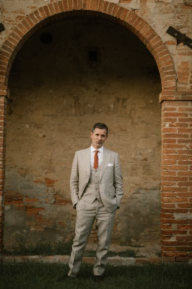 Groom in Beige Suit with Ochre Tie   Fairytale Tuscan Wedding with Bride in Embroidered Dress   Andrea & Federica Photography