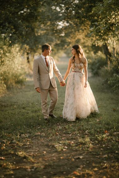 Bride in Strapless Embroidered Wedding Dress by Rara Avis   Groom in Beige Suit with Ochre Tie   Golden Hour   Fairytale Tuscan Wedding with Bride in Embroidered Dress   Andrea & Federica Photography