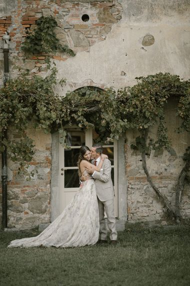 Bride in Strapless Embroidered Wedding Dress by Rara Avis   Groom in Beige Suit with Ochre Tie   Fairytale Tuscan Wedding with Bride in Embroidered Dress   Andrea & Federica Photography