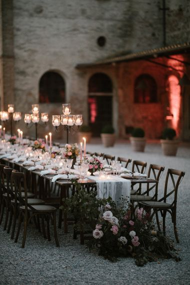 Wedding Reception Decor   Romantic Table Flowers   Soft Linen Table Runner   Burnished Iron Candlesticks   Pink Tapered Candles   Fairytale Tuscan Wedding with Bride in Embroidered Dress   Andrea & Federica Photography