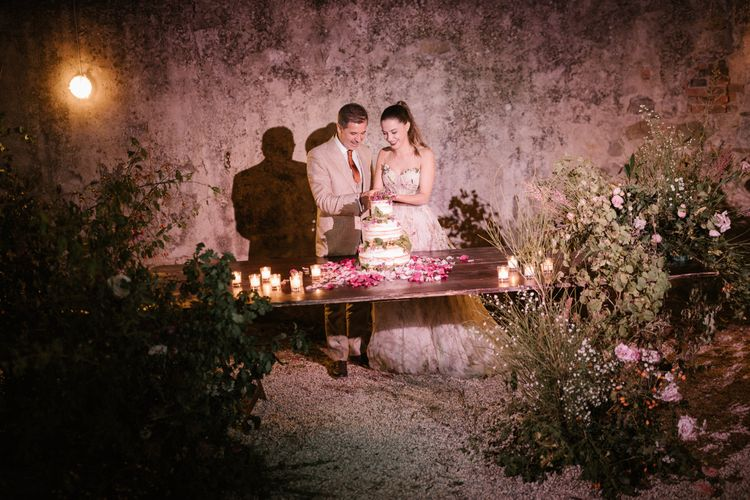 Cake Cutting   Naked Wedding Cake   Pink Petals   Tea Lights   Fairytale Tuscan Wedding with Bride in Embroidered Dress   Andrea & Federica Photography