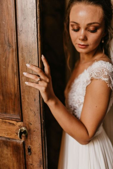 Bride in Bespoke Wedding Dress with Lace Bodice Showing Off Her Diamond Engagement Ring