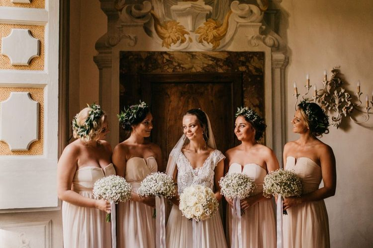 Bridal Party Portrait with Bridesmaids in Pink Dresses Holding Gypsophila Bouquets and Flower Crowns and Bride in Bespoke Wedding Dress