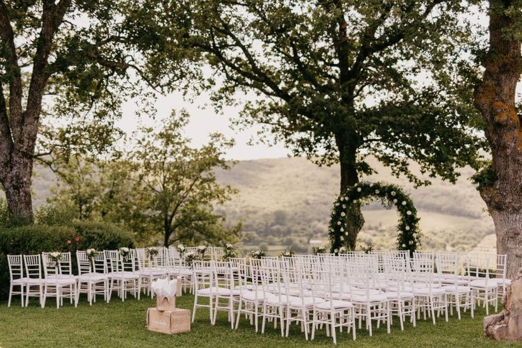 Outdoor Wedding Ceremony with Floral Arch