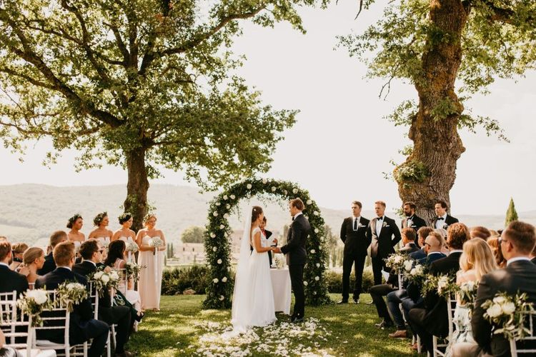 Bride and Groom Exchanging Vows at an Outdoor Wedding Ceremony