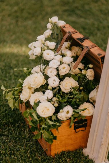 Wooden Trunk Filled with White Roses and Foliage
