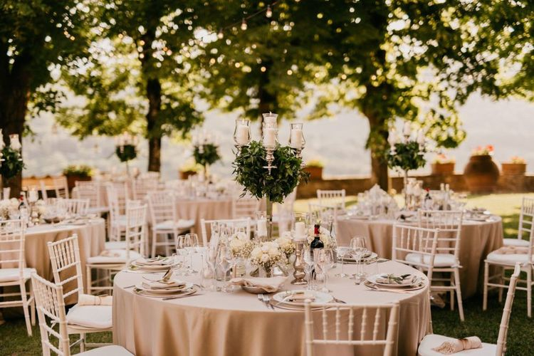 Outdoor Reception with Candelabra Centrepiece Covered in Foliage