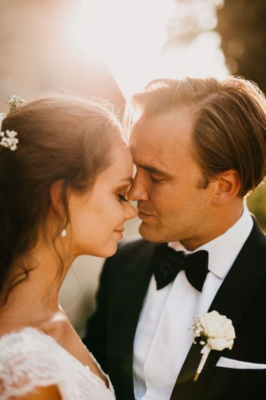 Intimate Golden Hour Portrait with Bride and Groom Embracing