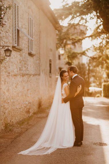 Golden Hour Portrait with Bride in Bespoke Wedding Dress and Groom in Black Tie Suit