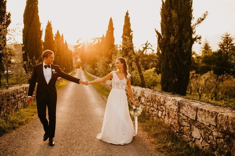Golden Hour Portrait with Bride in Bespoke Wedding Dress and Groom in Tuxedo and Bow Tie