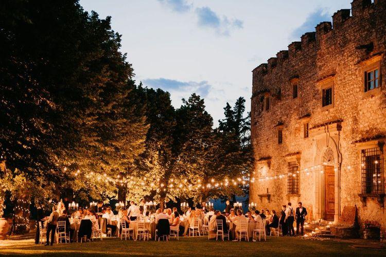 Italian Castle Outdoor Wedding Reception Lit Up with Festoon Lights
