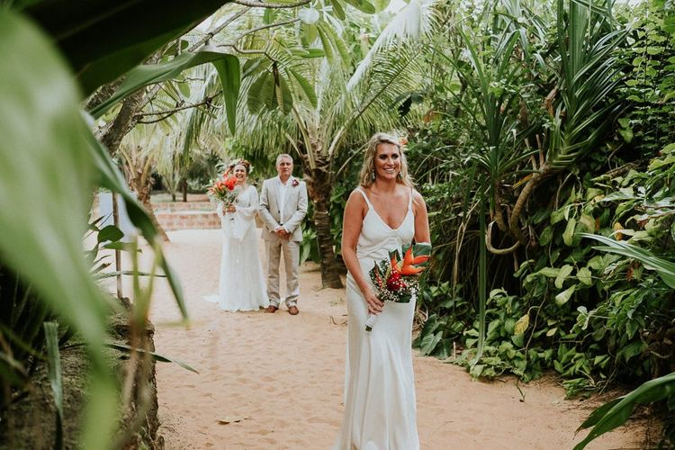 Bridesmaid In White Dress Walking Down Aisle
