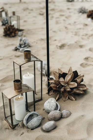 Lanterns and Pebbles Beach Wedding Decor