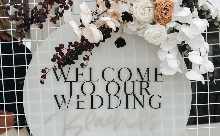Acrylic Welcome To Our Wedding Sign Decorated with Muted Wedding Flowers