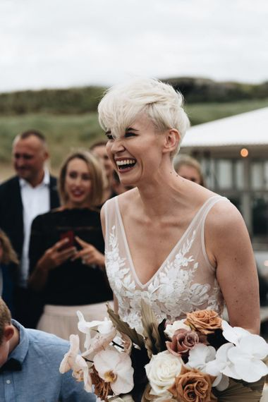 Smiley Bride with Short Hair in Made With Love Wedding Dress