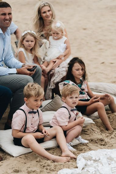 Children Sitting on the Beach During Wedding Ceremony