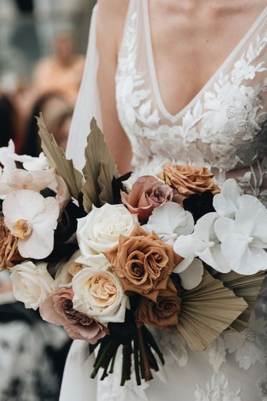 Muted Wedding Bouquet with Dried Palm Leaves, Orchids and Roses