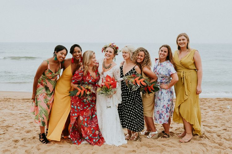 Bride Joined By Guests for Beach Portrait