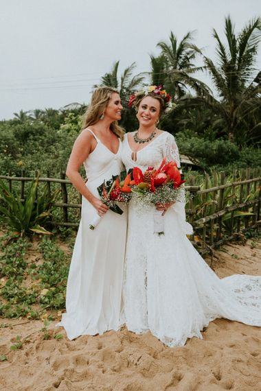 Bride and Bridesmaid With Bright Floral Bouquets