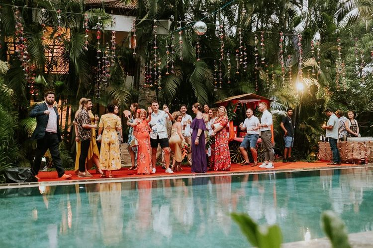 Guests Gather Poolside For Drinks Reception