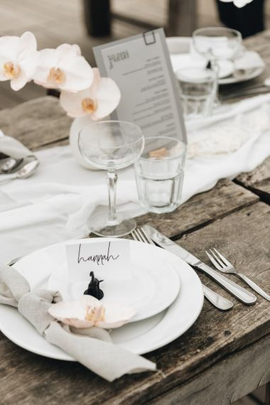 Place Setting with White Place, and Linen Napkin